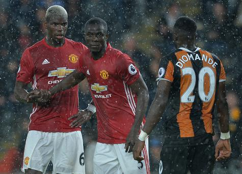 HULL, ENGLAND - AUGUST 27: Paul Pogba (L1), of Manchester United with Eric Bailly of Manchester United (L2), during the Premier League match between Manchester United FC and Hull City FC at KC Stadium on August 27, 2016 in Hull, England. (Photo by Mark Runnacles/Getty Images)