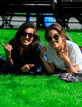 Sylvia Negra from Lecce in southern Italy and Regina Soto from Mexico City enjoy the good weather at St Stephen's Green, Dublin. Photo: Gareth Chaney Collins