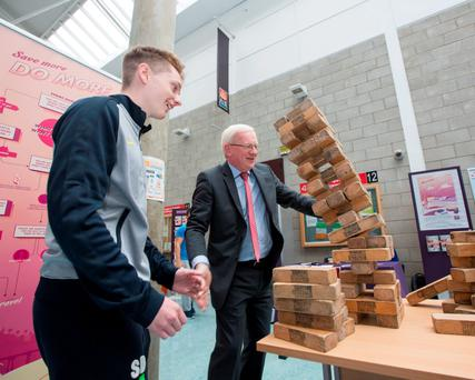 Professor Vincent Cunnane, the new president of Limerick Institute of Technology, watches the bricks topple as he plays a game of Jenga with first-year LIT student Patrick O'Brien, from Nenagh, Co Tipperary. Photo: Sean Curtin/True Media