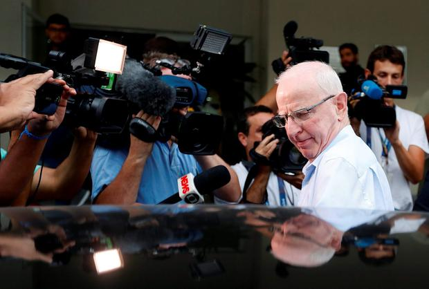 Pat Hickey leaves a police station
