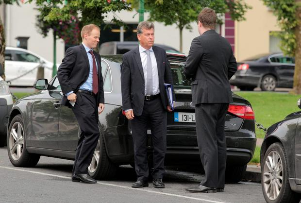 Mr. Paul Fogarty, Junior Counsel for Volkswagen, centre with colleagues at Castlebar District Court, Co. Mayo for a case taken by Eithne Higgins from Co Roscommon against Volkswagen. Photo : Keith Heneghan / Phocus