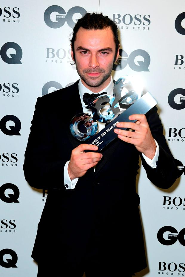 Aidan Turner with the award for Best Television Actor in the press room at the GQ Men of the Year Awards 2016