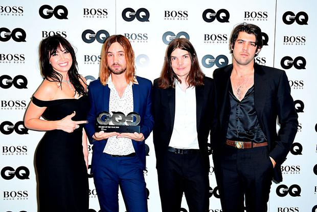 (Left to right) Daisy Lowe presents Kevin Parker, Dominic Simper and Cam Avery of Tame Impala with the award for Best Band press room at the GQ Men of the Year Awards 2016