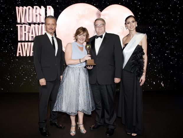 Pictured receiving the Ireland's Leading Hotel 2016 award at the world travel awards gala ceremony are Deirdre O' Brien (2nd from left), sales and marketing director at Powerscourt Hotel, Resort and Spa (centre left) and Ian Wynne (2nd from right), General Manager at Powerscourt Hotel Resort and Spa with World Travel Awards President Graham Cooke and Simeone Latini. Photo: Mark Stedman