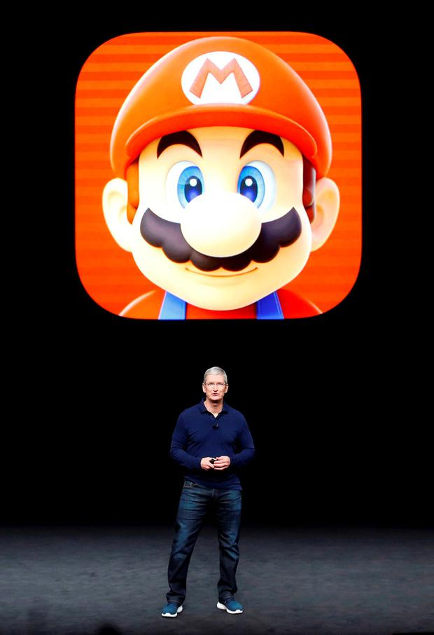 Apple Inc CEO Tim Cook speaks in front of a Mario Bros. image during an Apple media event in San Francisco, California, U.S. September 7, 2016. Reuters/Beck Diefenbach