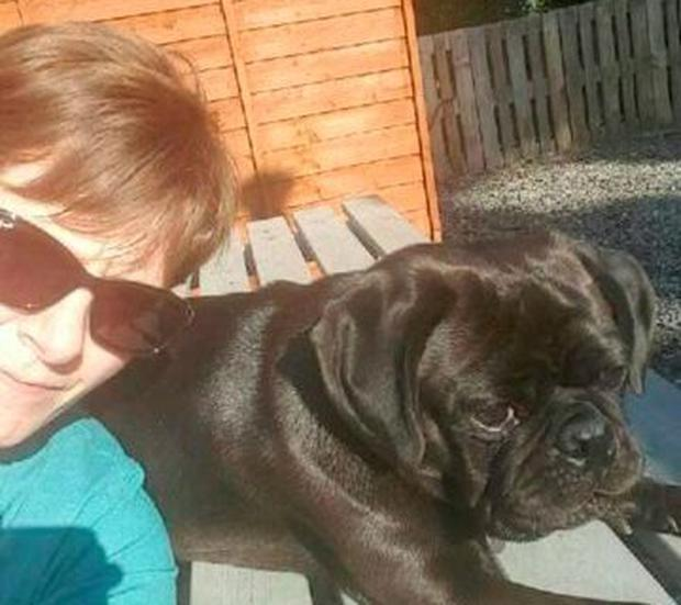 Donna poses for a selfie with her dog