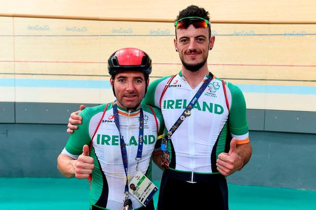 Damien Vereker and his pilot Sean Hahessy pose after a training session in the Velodrome. Photo by Diarmuid Greene/Sportsfile