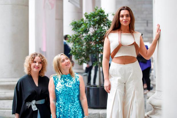 Katie Donohoe (left) with Ruth ní Loinsigh (centre) of Om Diva at the Young Designer of the Year competition on College Green yesterday. Photo: Andres Poveda