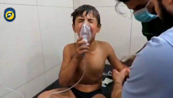 A boy is treated after a suspected chlorine gas attack in Aleppo. Photos: Reuters