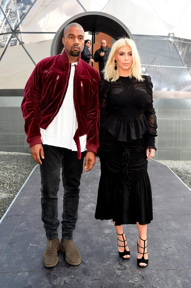 (L-R) Kanye West and Kim Kardashian attend the Louis Vuitton show as part of the Paris Fashion Week Womenswear Fall/Winter 2015/2016 on March 11, 2015 in Paris, France. (Photo by Pascal Le Segretain/Getty Images)