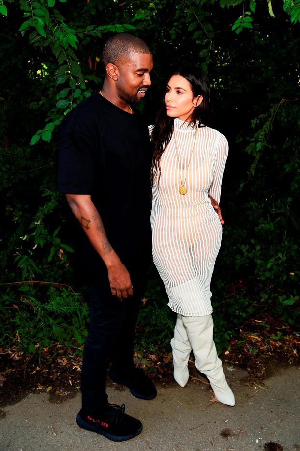 Kanye West and Kim Kardashian attend the Kanye West Yeezy Season 4 fashion show on September 7, 2016 in New York City. (Photo by Jamie McCarthy/Getty Images for Yeezy Season 4)