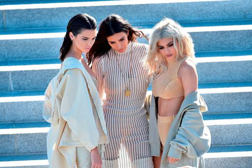 (L-R) Kendall Jenner, Kim Kardashian and Kylie Jenner attend the Kanye West Yeezy Season 4 fashion show on September 7, 2016 in New York City. (Photo by Bryan Bedder/Getty Images for Yeezy Season 4)