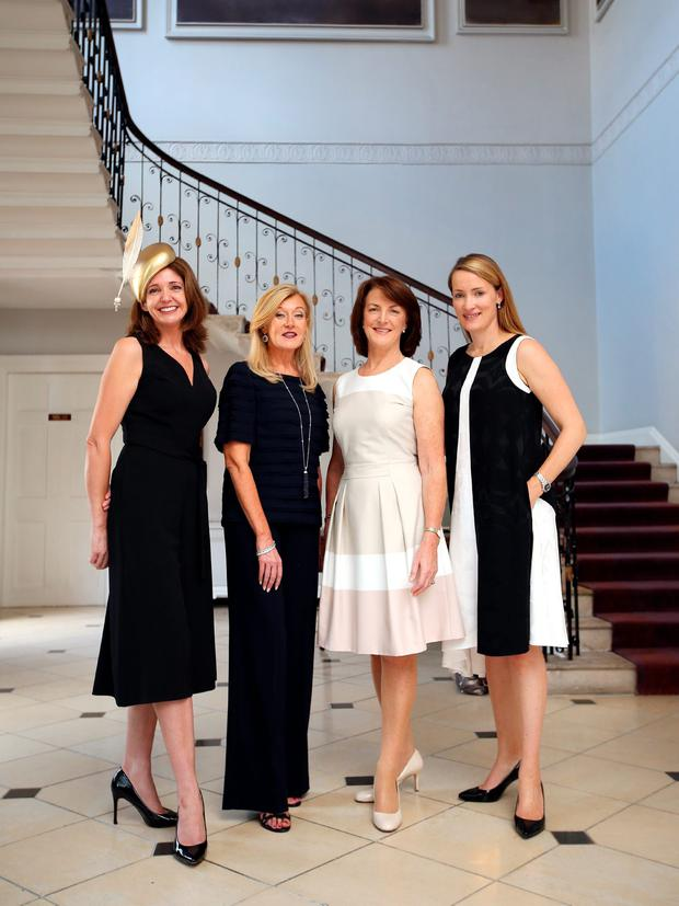 Power dressers (from left): Milliner Carol Kennelly, fashion designer, Louise Kennedy, Eimear Mulhern, chairperson of Goffs and Tamso Doyle of Baroda Stud, photographed at the Merrion Hotel before the Irish Racing Style lunch. Photo: Frank McGrath