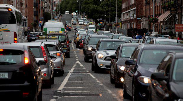 Commuters make their way through the city as bus workers strike in Dublin