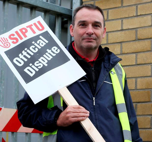 A striking driver outside Donnybrook bus depot. Photo: Laura Hutton/Collins Photo Agency