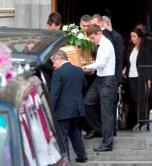 Nicola's coffin is carried to the hearse. Photo: Colin O'Riordan