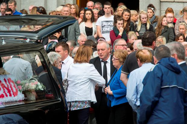 Nicola's father, Patrick is comforted by friends and relatives. Photo: Colin O'Riordan