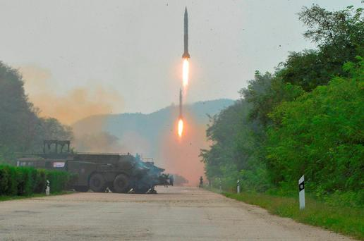 This undated released by the North Korean government, shows ballistic missiles launched during a drill at an undisclosed location in North Korea. Photo: AP