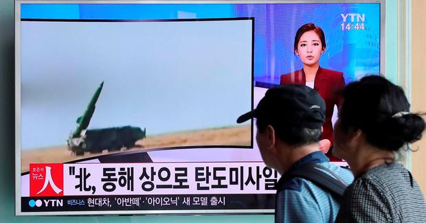 People watch a TV news program reporting about North Korea's missile launch, at the Seoul Train Station in Seoul, South Korea. Photo: AP