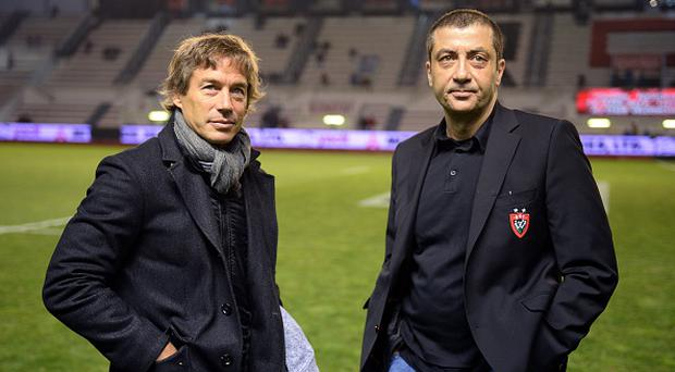 Toulon president Mourad Boudjellal (R) stands next to new coach Diego Dominguez (L) for the 2015-2016 season on March 7, 2015 before a French Top 14 rugby union match between RC Toulon and Brive at the Mayol stadium in the southeastern French city of Toulon. AFP PHOTO / BORIS HORVAT (Photo credit should read BORIS HORVAT/AFP/Getty Images)