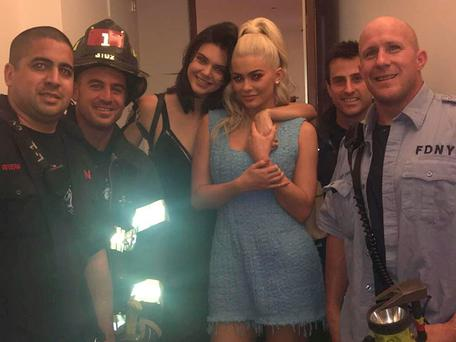 Kendall and Kylie Jenner with members of the New York Fire Department after being rescued from an elevator. Picture: Kylie Jenner/Snapchat