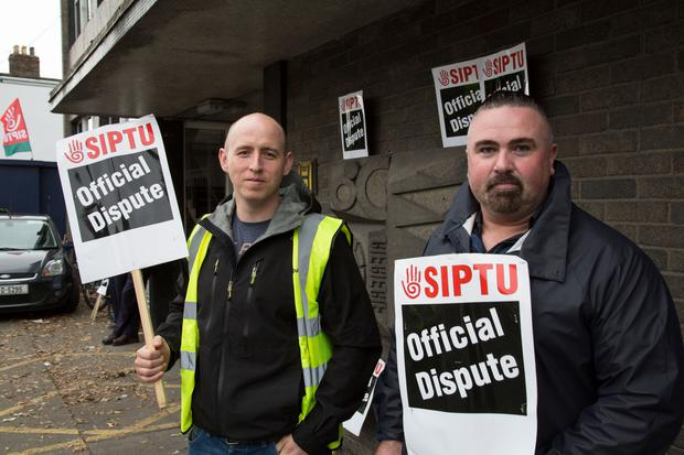 Striking Bus drivers, Aidan McCabe and Garrett Pimlott at The Conyngham Road Depot picket today. PIC Colin O'Riordan