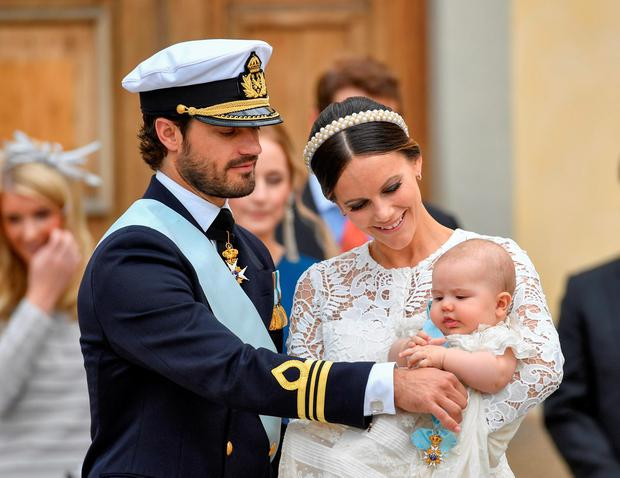 Sweden's Princess Sofia, right, smiles as she holds her five month-old son Prince Alexander next to Prince Carl Philip, left, after Alexander's christening at Drottningholm Palace, Stockholm, Friday, Sept. 9, 2016. (Anders Wiklund / TT via AP)