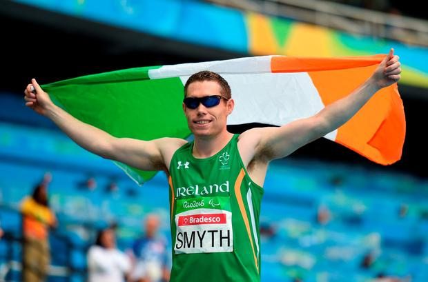 Jason Smyth of Ireland celebrates with the Ireland flag after winning the Men's 100m T13 Final, with a time of 10.64, at the Rio Olympic Stadium during the Rio 2016 Paralympic Games in Rio de Janeiro, Brazil. Photo by Diarmuid Greene/Sportsfile