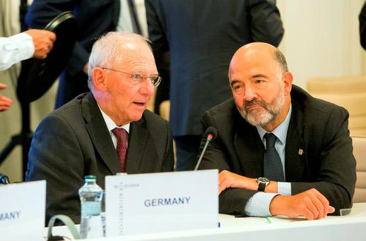 German Finance Minister Wolfgang Schauble (left) with EU Commissioner Pierre Moscovici in Bratislava. Photo: AP