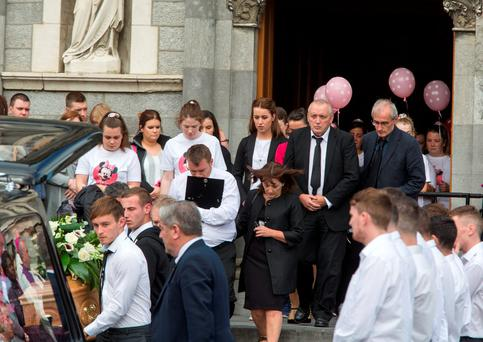 Nicola's father Patrick Kenny and friends and relatives follow her coffin from the Cathedral of the Assumption in Thurles. Photo: Colin O'Riordan