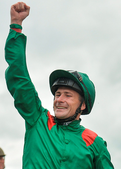 Pat Smullen waves to the Curragh crowd after partnering Harzand to victory in the Irish Derby for Dermot Weld. Photo: Cody Glenn/Sportsfile