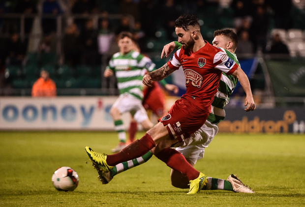 Sean Maguire beats Sean Heaney to score his side's fifth goal Photo by David Maher/Sportsfile