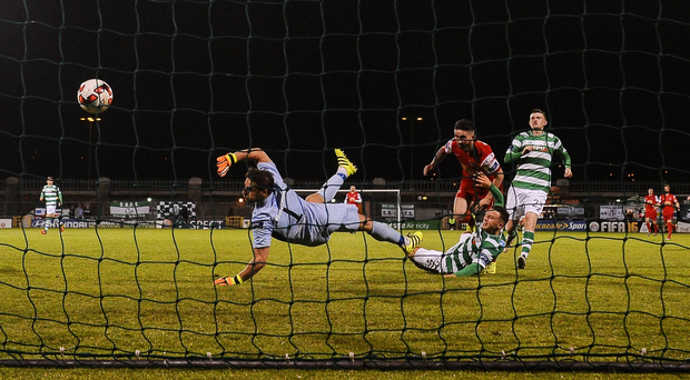 Sean Maguire beats Barry Murphy, goalkeeper of Shamrock Rovers to score his side's fourth goal Photo by David Maher/Sportsfile