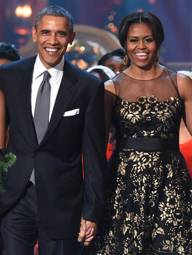 U.S. President Barack Obama and First Lady Michelle Obama speak onstage at TNT Christmas in Washington in December 2014 (Photo by Theo Wargo/WireImage)