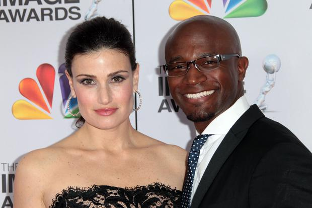 LOS ANGELES, CA - FEBRUARY 17: Actress Idina Menzel (L) and ex-husband, actor Taye Diggs arrive at the 43rd NAACP Image Awards held at The Shrine Auditorium on February 17, 2012 in Los Angeles, California. (Photo by Frederick M. Brown/Getty Images for NAACP Image Awards)