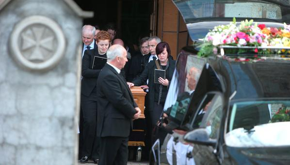 Partner, Anne Marie Ryan and sister, Leanne, either side of the coffin after the funeral mass of Donna Fox at S.S. Peter and Paul's Church, Balbriggan Credit: Damien Eagers