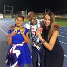 Runner Mo Farah with wife Tania and daughter Rhianna, who holds his new gold medal.