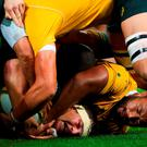 South Africa's centre Jesse Kriel (lower L) and Australia's prop Sekope Kepu (lower R) compete for the ball during the Rugby Championship match between Australia and South Africa at Suncorp Stadium in Brisbane