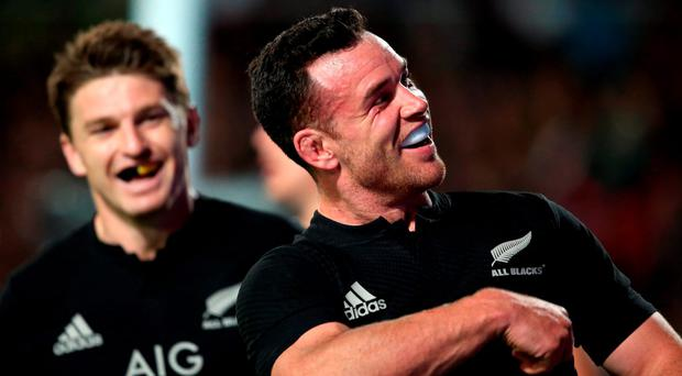 New Zealand's centre Ryan Crotty (R) celebrates a try during the Rugby Championship match between the New Zealand All Blacks and Argentina at FMG Stadium Waikato in Hamilton