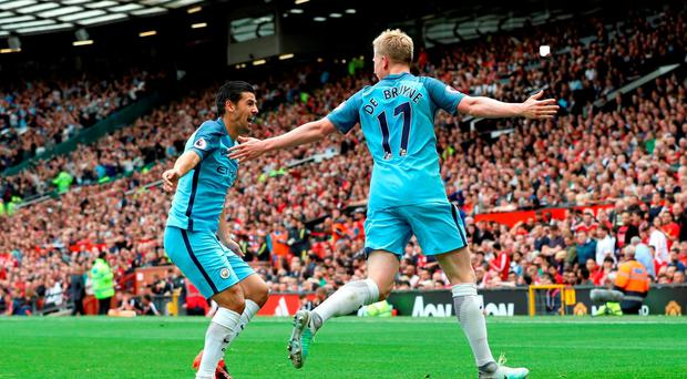 Manchester City's Kevin De Bruyne celebrates scoring his side's first goal of the game with teammate Nolito