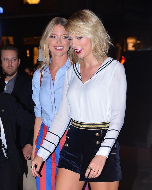 Taylor Swift and Martha Hunt arrive at the Tommy Hilfiger New York Fashion Week show on September 9, 2016 in New York City. (Photo by Robert Kamau/GC Images)