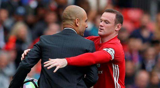 Manchester United's Wayne Rooney clashes with Manchester City manager Pep Guardiola Reuters / Phil Noble