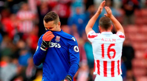 Stoke City goalkeeper Shay Given leave the pitch dejected after the final whistle