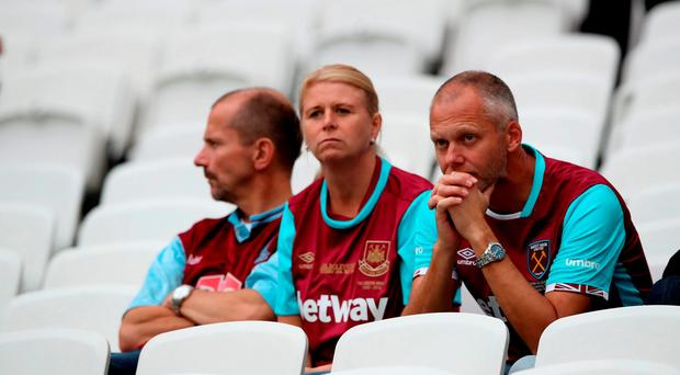 West Ham United fans appear dejected after the final whistle