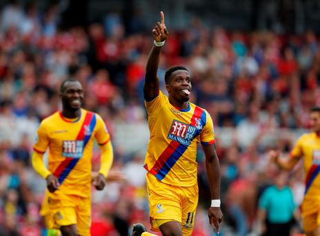 Crystal Palace's Wilfried Zaha celebrates scoring their winner Action Images via Reuters / Ed Sykes