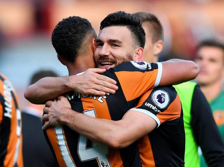 Hull City's Robert Snodgrass with Jake Livermore at the end of the match Reuters / Anthony Devlin