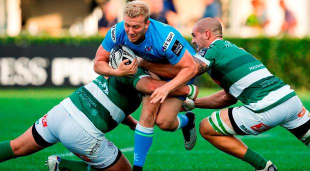 Stuart Olding of Ulster is tackled by Marco Lazzaroni, right, and Nicola Quaglio of Benetton Treviso during the Guinness PRO12 Round 2 match between Benetton Treviso and Ulster at the Stadio Monigo in Treviso, Italy. Photo by Roberto Bregani/Sportsfile