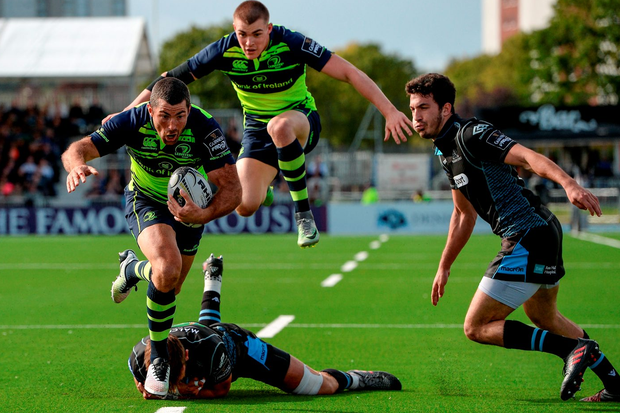 Leinster's Rob Kearney evades the tackle of Glasgow Warriors' Ryan Wilson on his way to scoring his side's first try. Photo: Seb Daly/Sportsfile