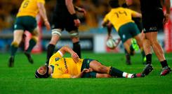 Matt Giteau lies in pain during the final moments of his international career. Photo: Mark Nolan/Getty Images