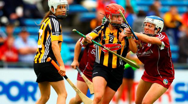 Kilkenny's Jacqui Frisby is tackled by Galway's Ailish O'Reilly. Photo: Ken Sutton/INPHO